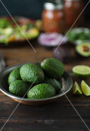 Avocados in a metal bowl