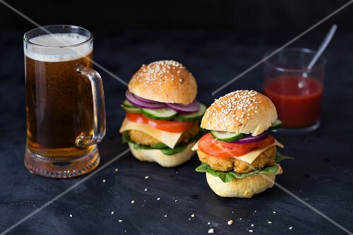 Homemade vegetarian quinoa burgers and a glass of beer