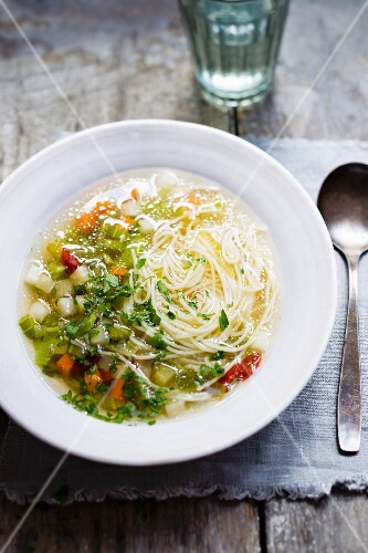 Noodle soup with vegetables and herbs