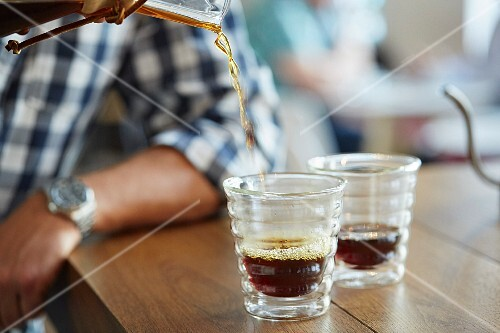 Filter coffee being poured into glasses