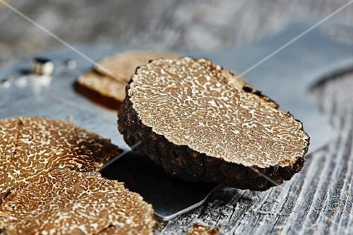 Summer or burgundy truffles (Tuber blotii) on a truffle slicer
