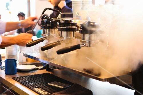 A man making an espresso in Balthasar, Vienna, Austria