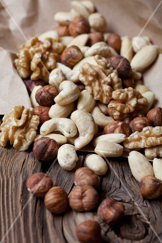 Assorted nuts on wooden background