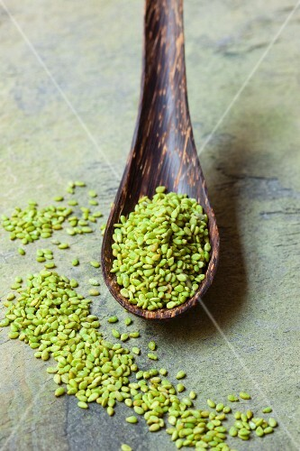 Wasabi sesame seeds on a wooden spoon