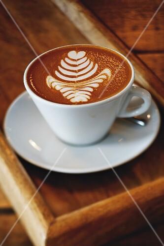 Coffee with a milk foam pattern