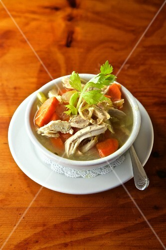 Homemade chicken soup with carrots and celery
