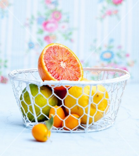 Various citrus fruit in a wire basket