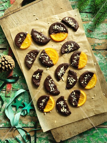 Candied oranges with chocolate glaze and coconut