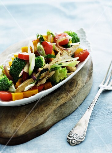 Mixed vegetable salad with turkey breast strips