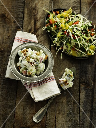 Two winter vegetable salads on a wooden surface