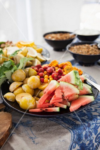A plate of fresh fruit on a buffet