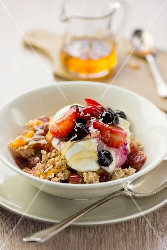 Oats with fruit, yoghurt and honey for breakfast