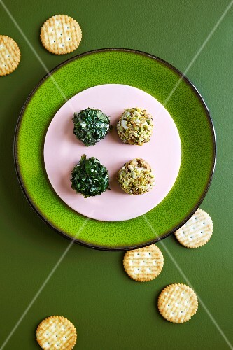 Cream cheese balls with herbs and chopped nuts