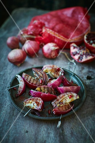 Grilled red onions with pomegranate molasses