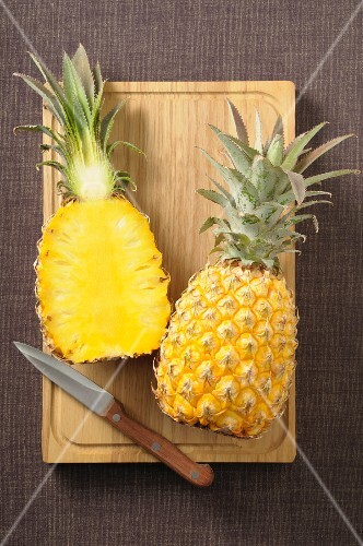A pineapple, halved