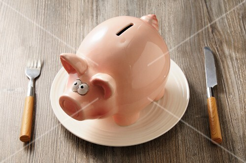 A piggy bank on a plate