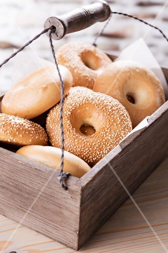 Bagels in a wooden crate with a carrying handle