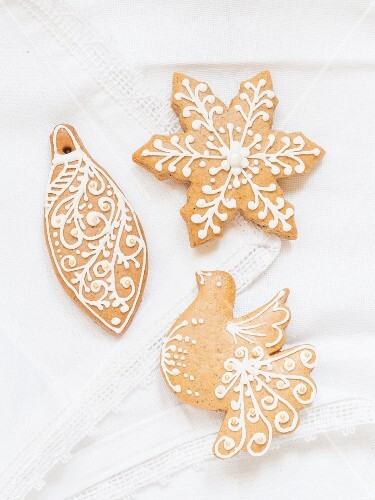 Homemade gingerbread biscuits decorated with white icing