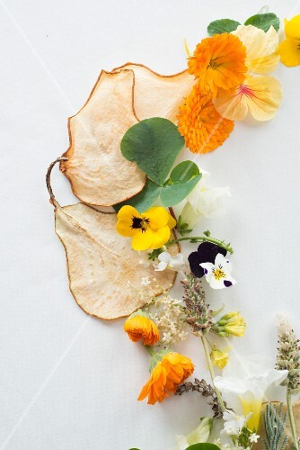 Various edible flowers and dried pear chips