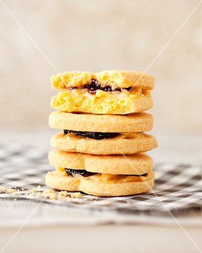 A stack of cream and jam sandwich biscuits