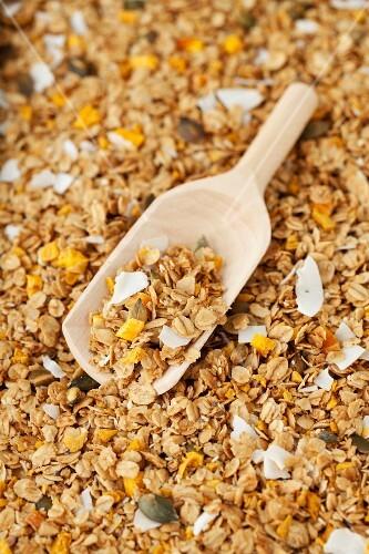 Granola muesli with dried mango pieces, coconut and vanilla