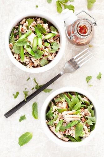 Wild rice salad with salmon, green asparagus and herbs (seen from above)
