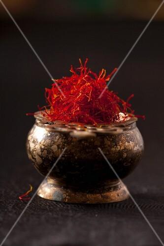 Saffron threads in a metal bowl