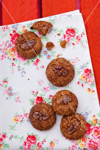 Walnut biscuits on a floral cloth