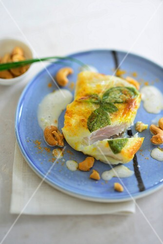Rosefish in rice paper with a coconut sauce, curry and cashew nuts