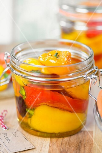 A jar of roasted and preserved peppers