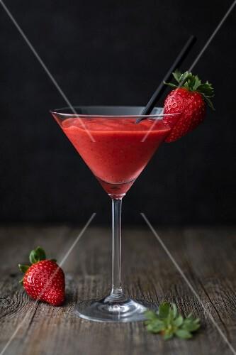 Strawberry daiquiri in a stemmed glass