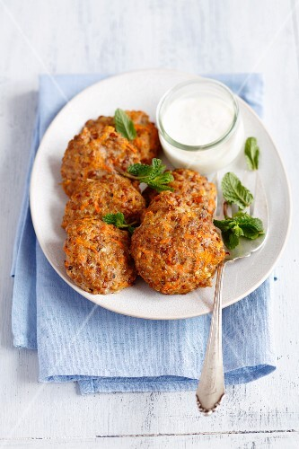 Oven-baked pork meatballs with carrots and buckwheat and a yoghurt dip