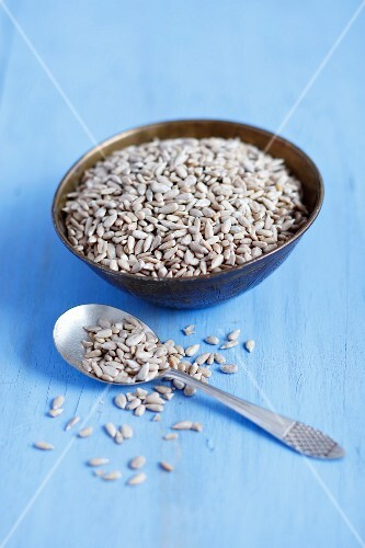 Sunflower seeds in a bowl and on a spoon