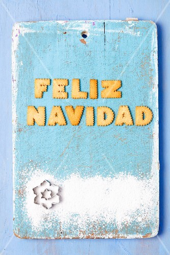 Christmas greetings written with biscuits in Spanish and cutters