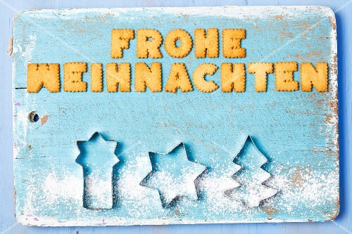 Christmas greetings written with biscuits in German and cutters