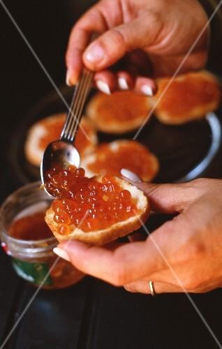 A canapé with salmon caviar