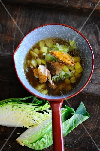 Cabbage soup with potatoes and smoked fish