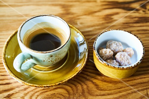 An espresso and cane sugar lumps