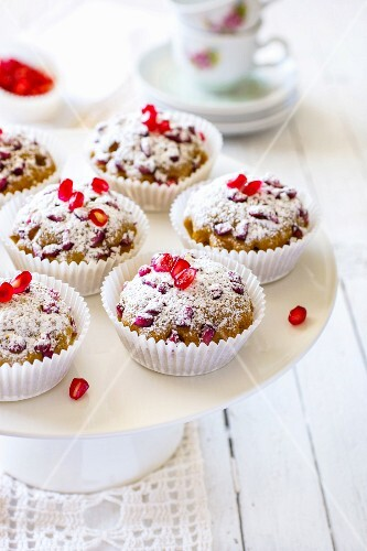 Pomegranate muffins with icing sugar