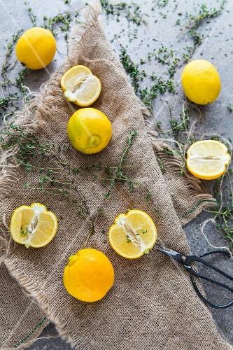 Lemons and thyme on a linen cloth