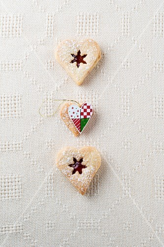 Vanilla hearts with jam and icing sugar