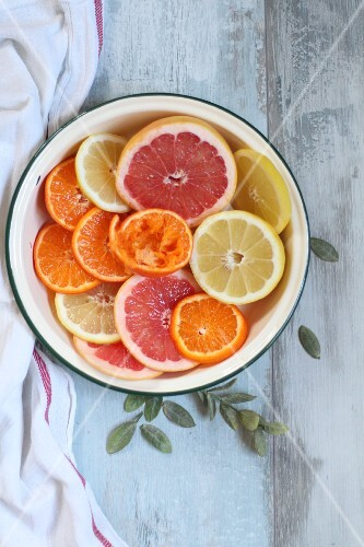 Citrus fruits in an enamel bowl