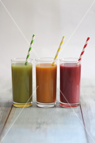 Three fruit and vegetable smoothies in different colours