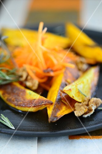 Oven-baked potatoes with rosemary, walnuts and a carrot salad
