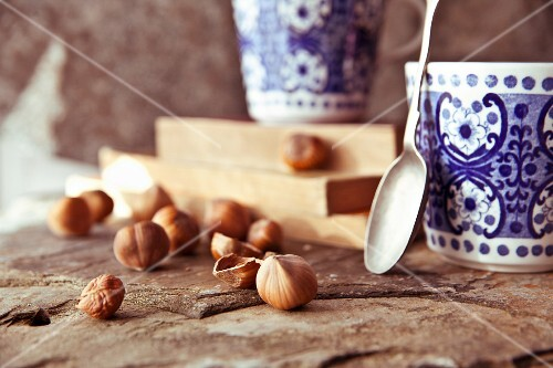 Coffee cups and hazelnuts