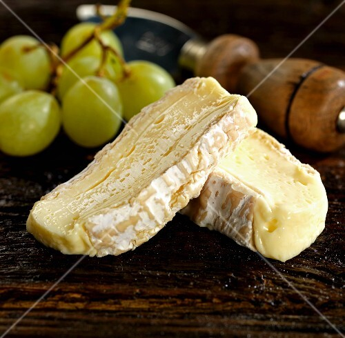 Brie de meaux with grapes and a cheese knife