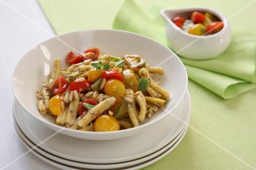 Pasta with colourful tomatoes, pine nuts and fresh oregano