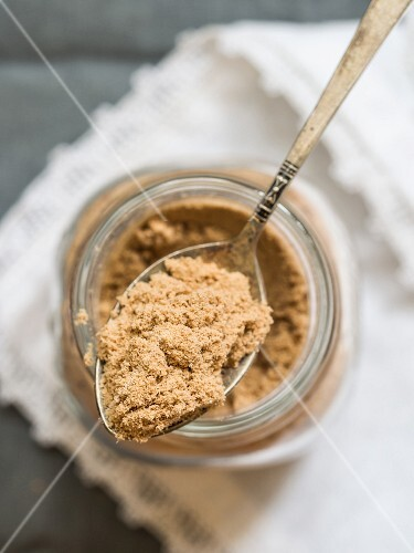 Organic African baobab powder in a jar and on a spoon
