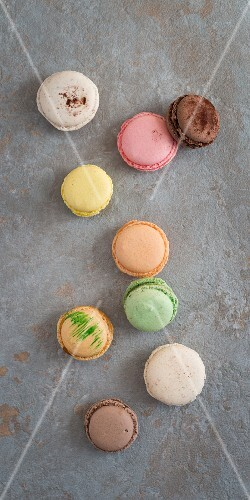 Various macaroons on a stone surface