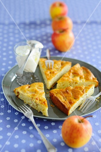 Slices of apple cake with cream